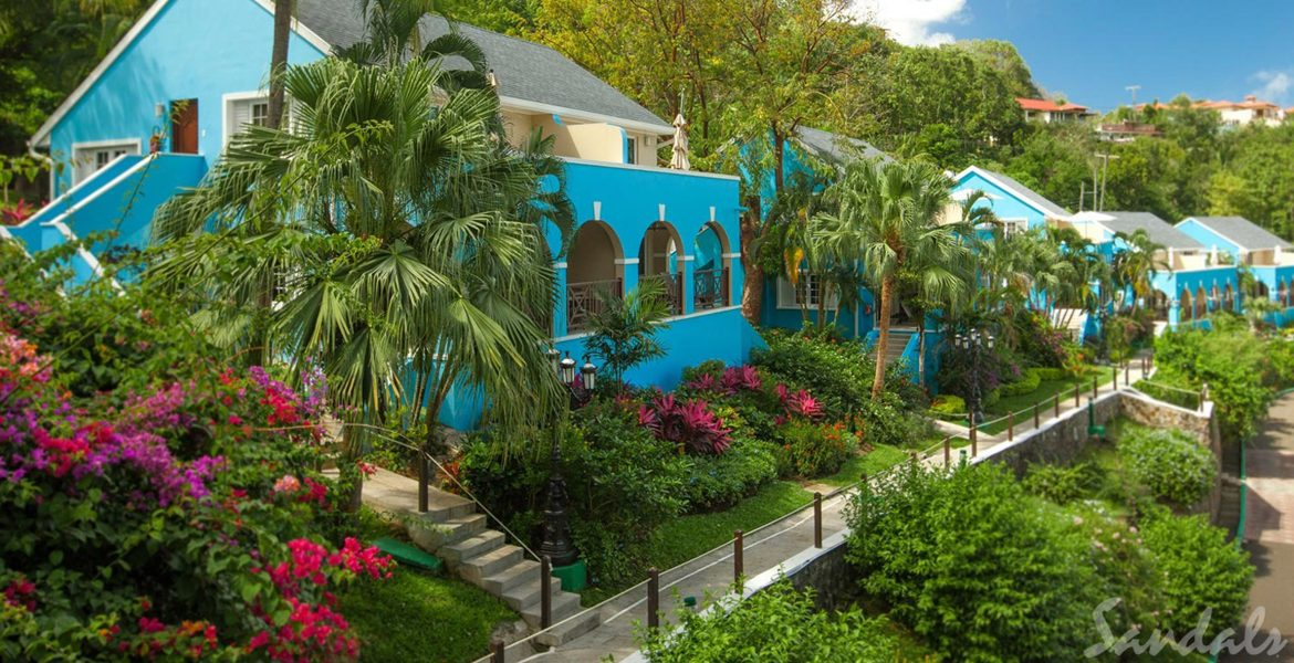blue-resort-villa-surrounded-by-flowers