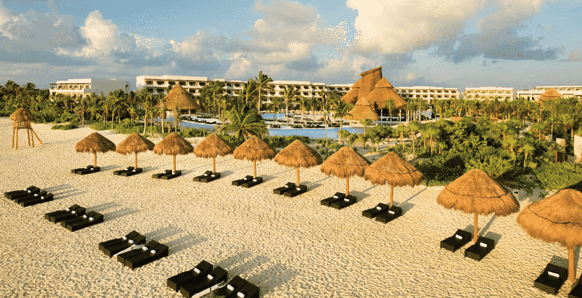 aerial-view-hotel-beach-tiki-umbrellas