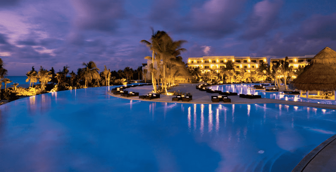 resort-pool-at-night-blue-water