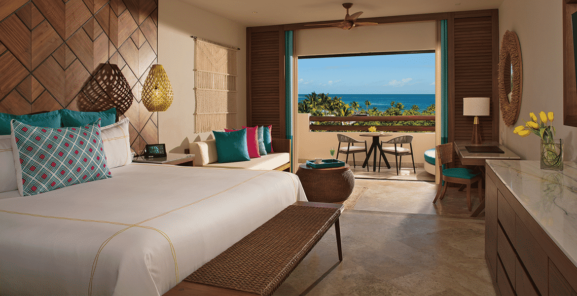 resort-suite-white-bed-ocean-view