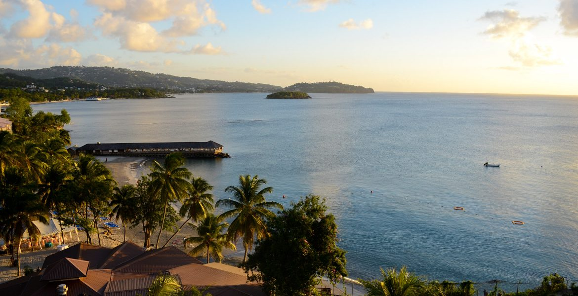 view-overlooking-blue-bay-with-palm-trees