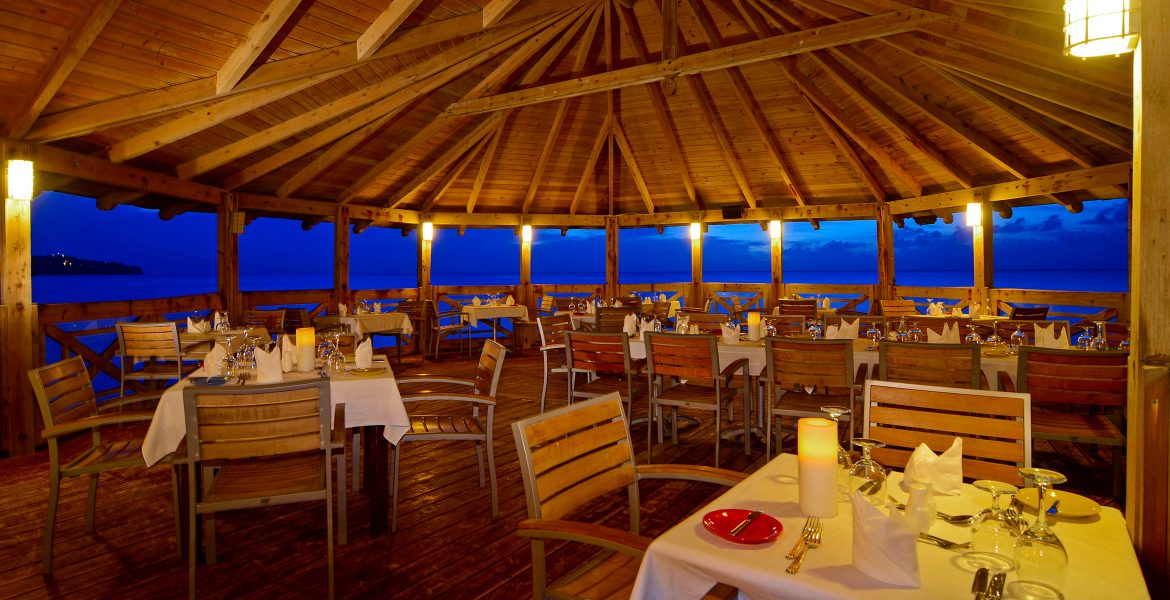 outside-dining-over-water-st-james-club-morgan-bay