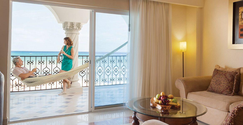 resort-suite-hammock-balcony-woman