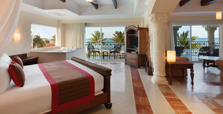 resort-suite-open-doors-dark-wood-bed