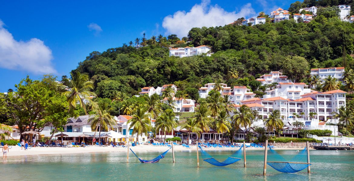overwater-hammocks-blue-cove-green-mountain-behind-windjammer-landing-resort-st-lucia