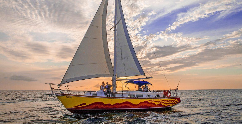 sailboat-sunset-blue-water