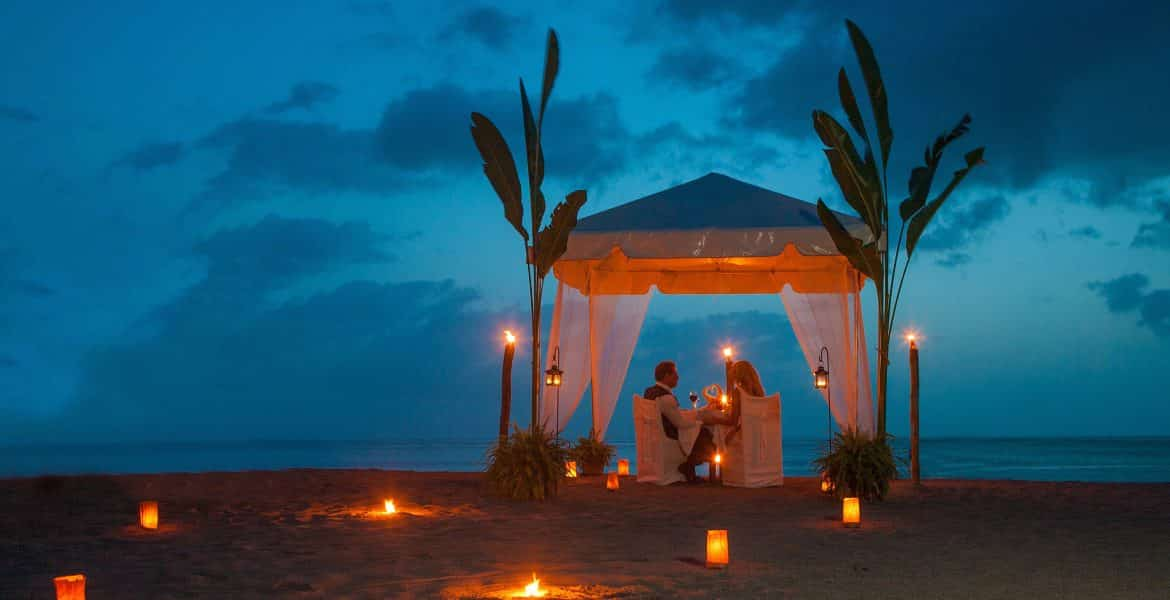 romantic-cabana-beach-sunset-couple