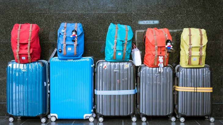 suitcases-colorful-backpacks-on-top
