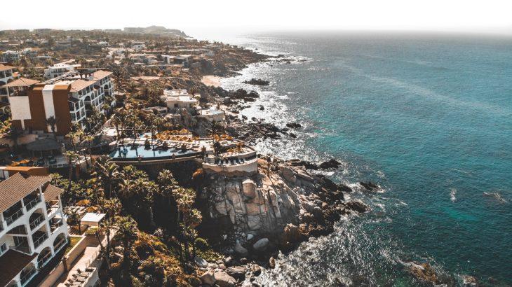 cabo-san-lucas-mexico-jagged-coastline-buildings-aerial-view