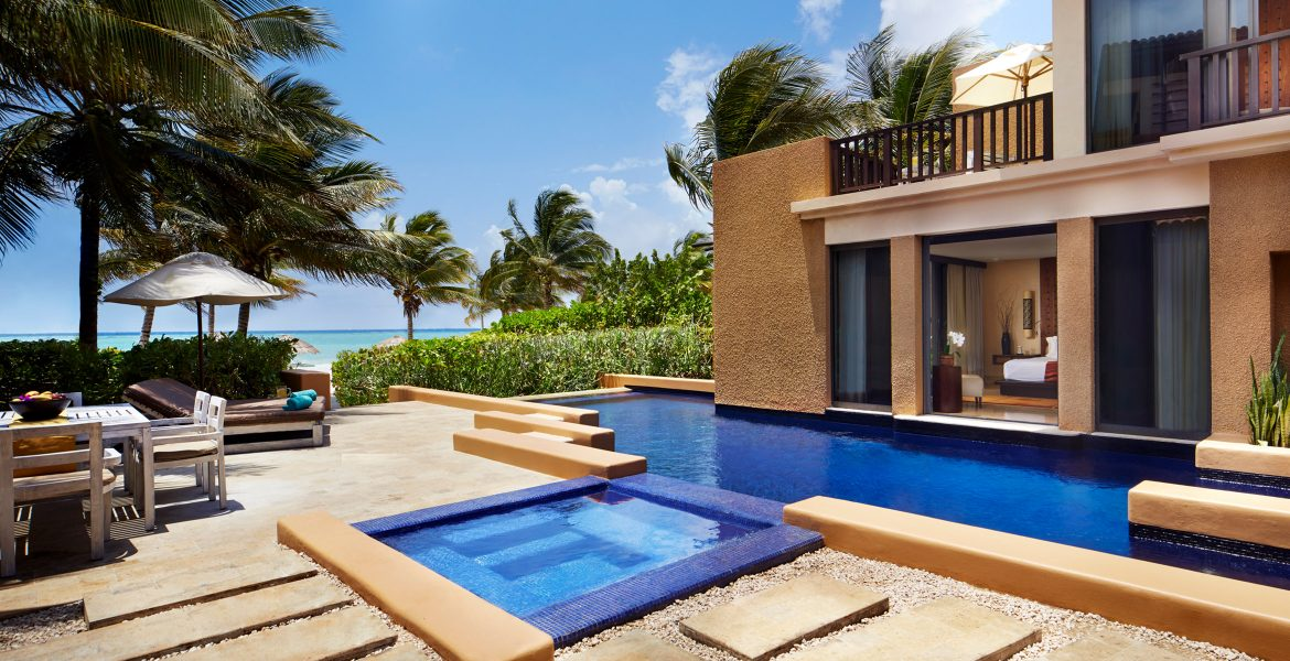 private-pool-at-resort-villa-surrounded-by-beach-jungle-blue-sky