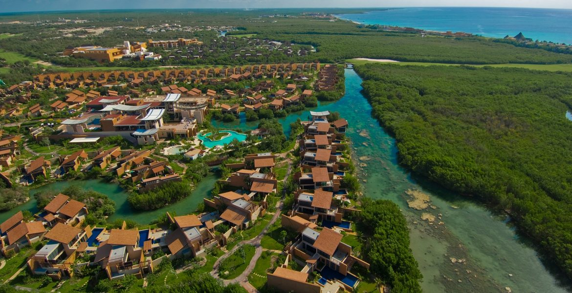 aerial-view-resort-buildings-on-turquoise-river