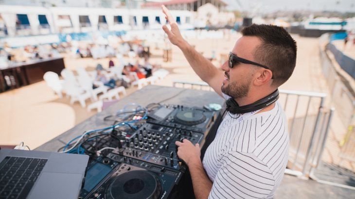 dj-in-booth-on-beach