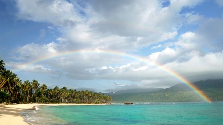 picturesque-beach-rainbow-over-turquoise-water
