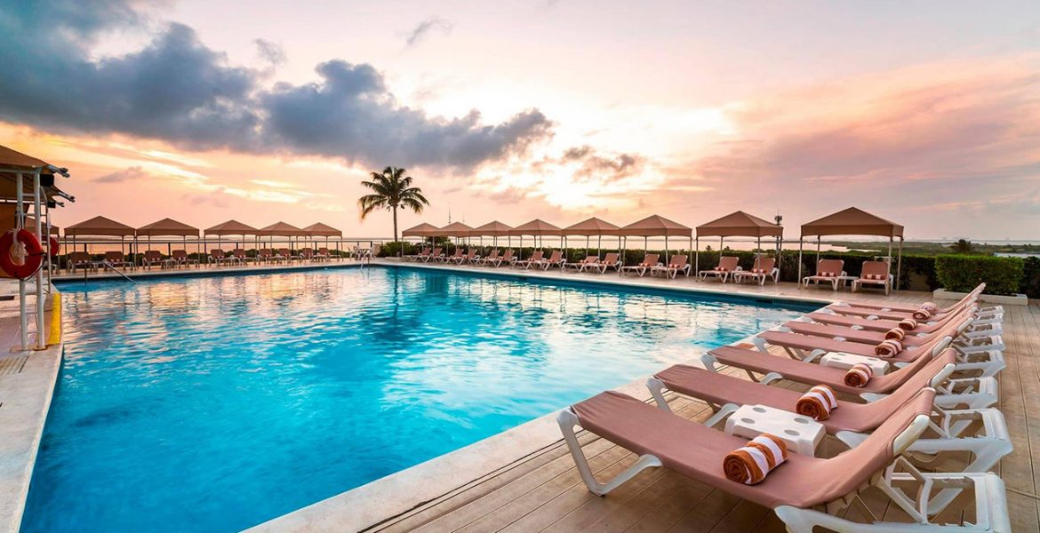 pool-umbrellas-loungers-sunset