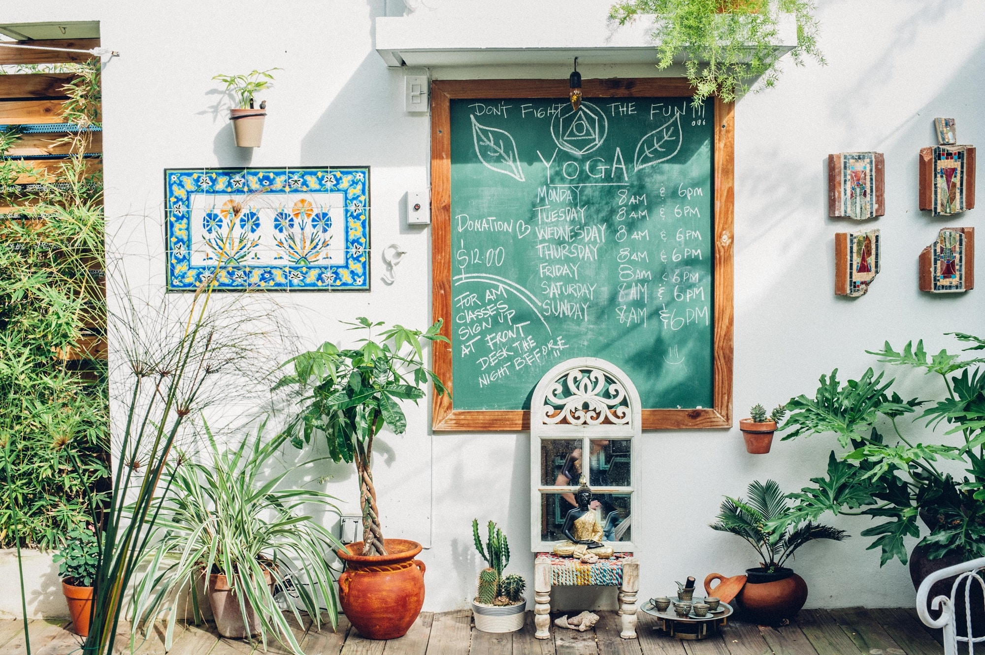 A chalkboard in the courtyard of the Dreamcatcher lists all of the yoga classes from which guests can choose
