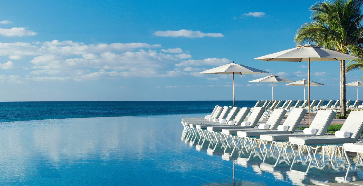 ocean-front-pool-white-umbrellas-loungers