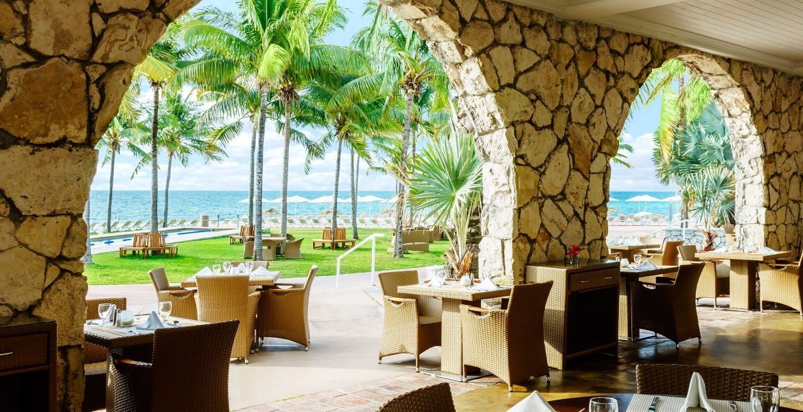 open-air-dining-view-green-palm-trees-blue-ocean