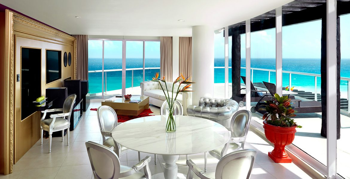 resort-suite-seating-area-ocean-view-glass-doors