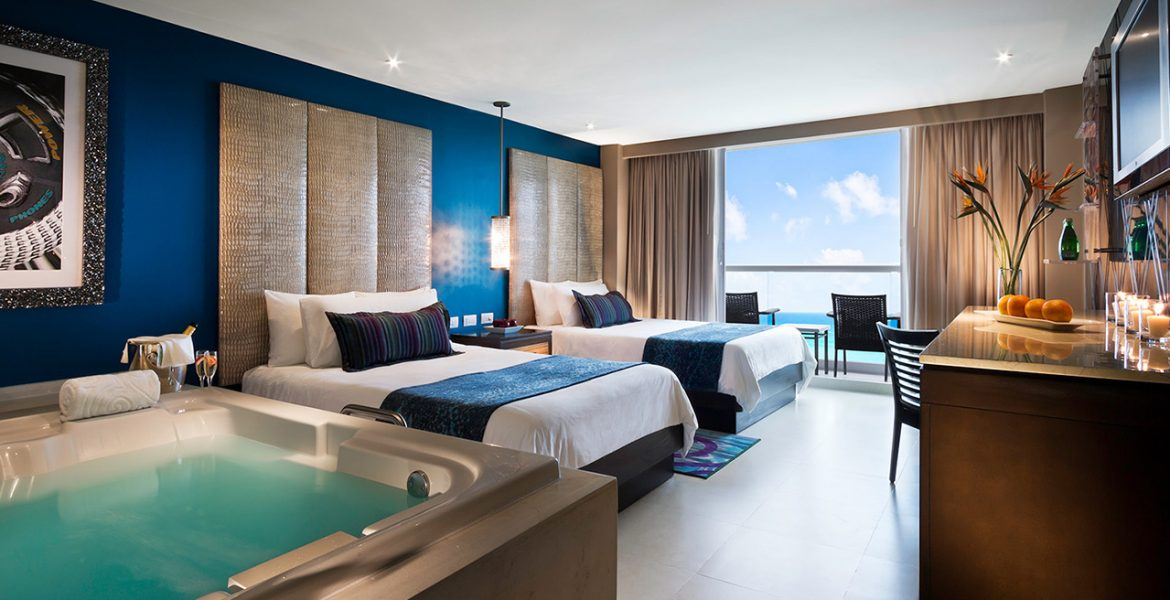 resort-suite-ocean-views-white-bed