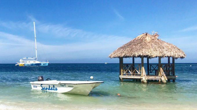 little-boat-in-water-hut-off-beach