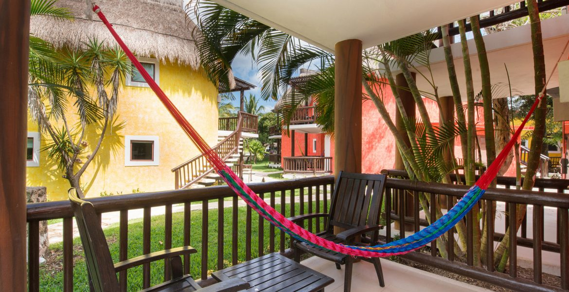 hotel-room-patio-with-pink-hammock-other-colorful-buildings