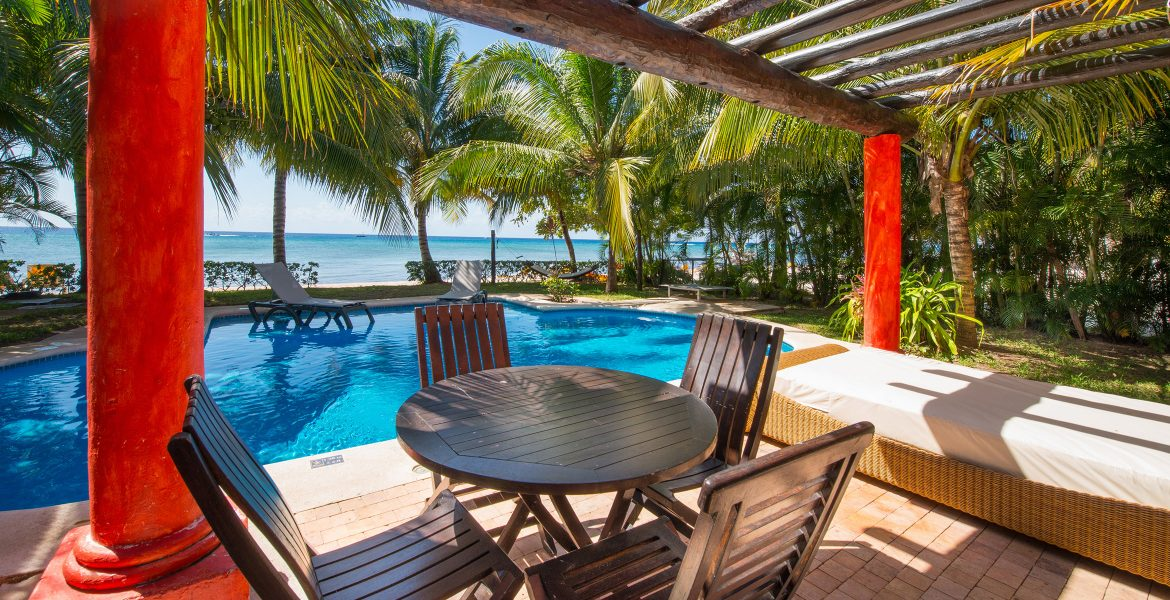 table-next-to-beach-front-pool