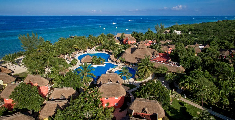 aerial-view-beach-resort-pools-orange-buildings