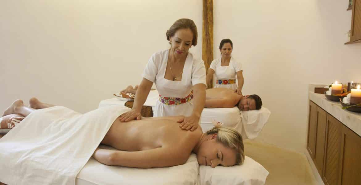 women-receiving-massage-beach-resort-spa