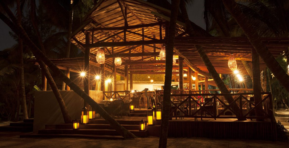 beach-hotel-lit-by-lanterns-nighttime