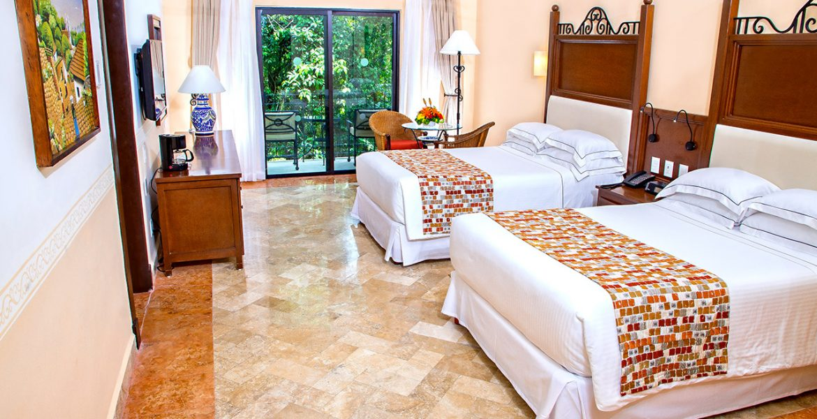 hotel-room-white-beds-jungle-view