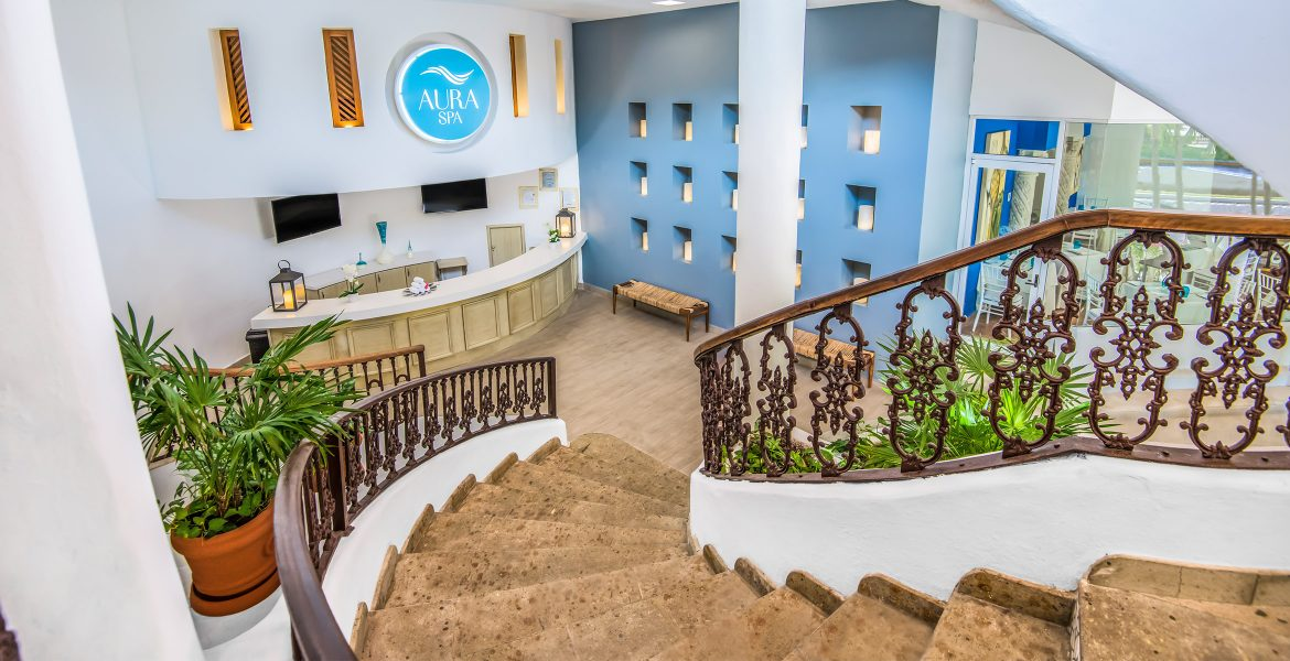 winding-staircase-blue-wall-front-desk