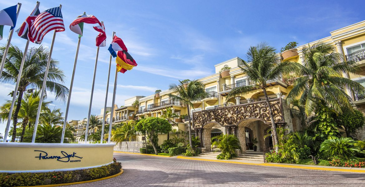 entrance-to-beach-resort-flags-blowing-in-wind