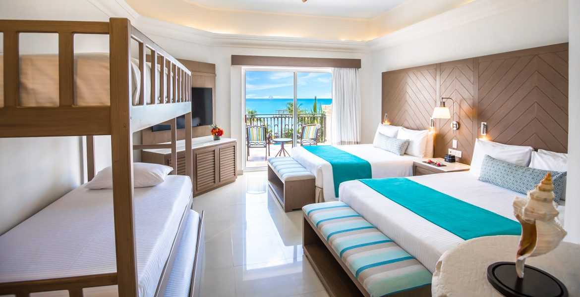 resort-suite-two-white-beds-turquoise-accent