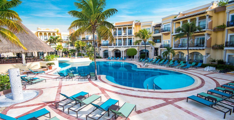 resort-pool-resort-building-green-palm-tree
