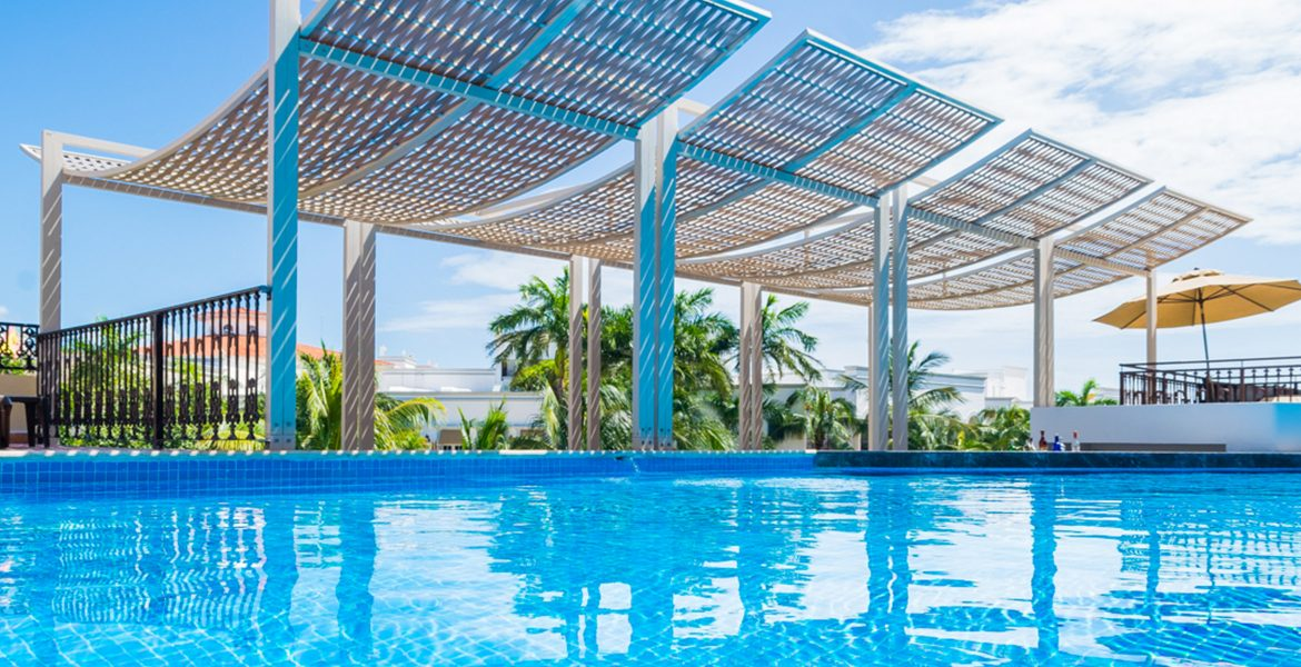 resort-bright-blue-pool-with-awning