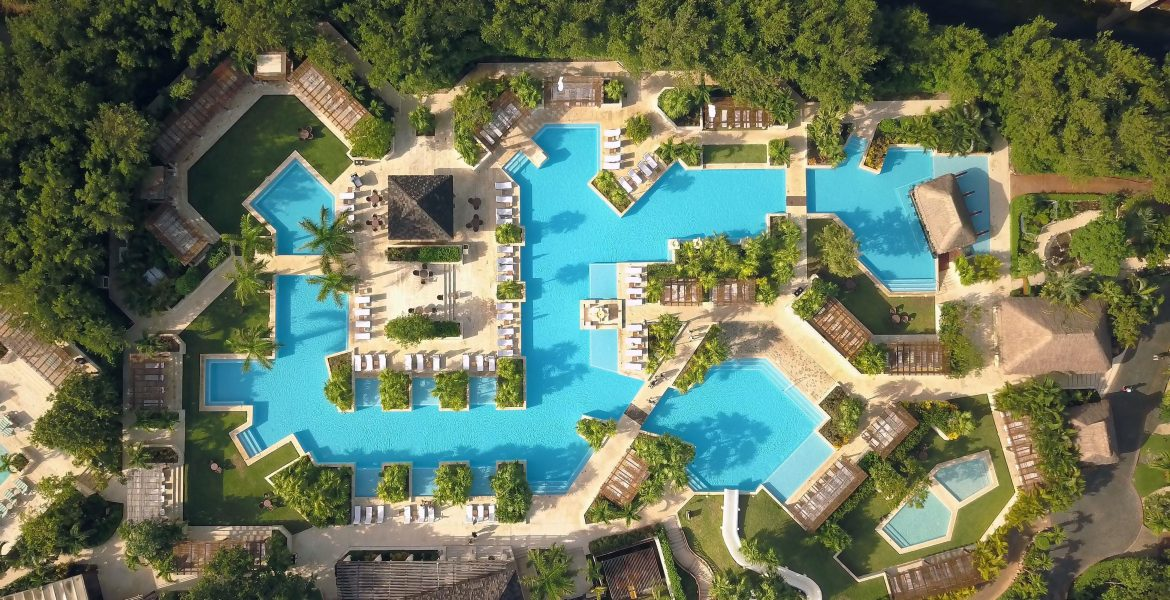 aerial-view-beach-resort-pool-palm-trees