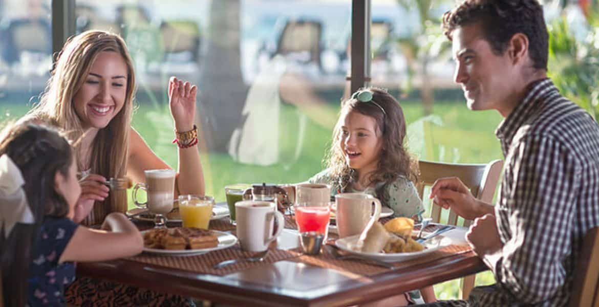 family-eating-breakfast-resort