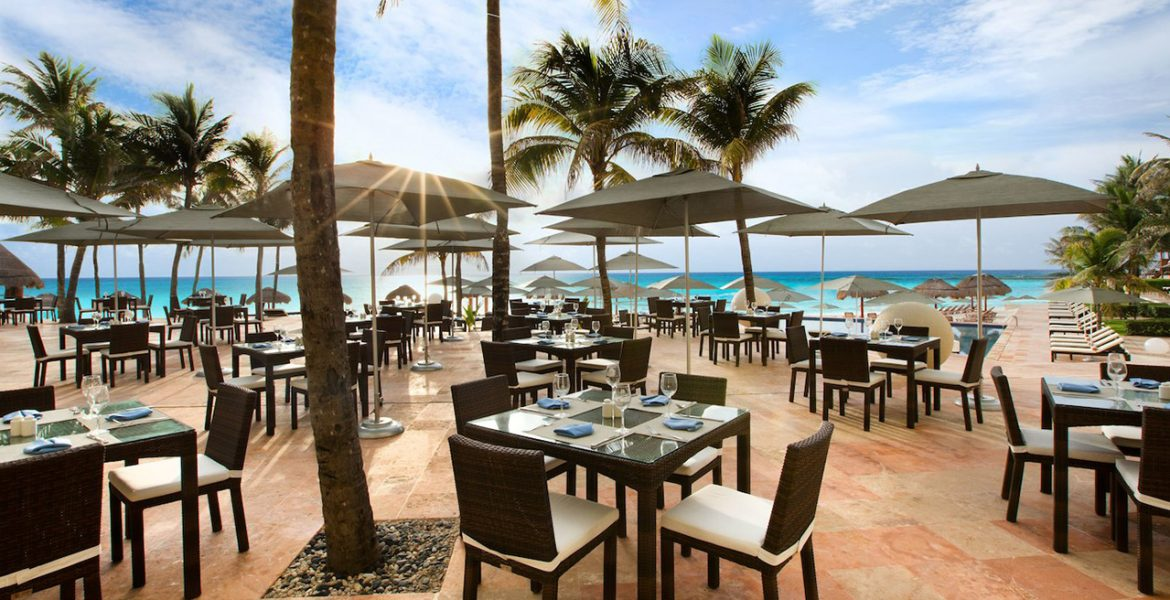open-air-dining-on-beach-palm-trees