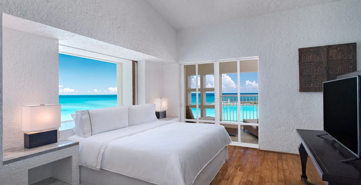 resort-suite-white-bed-balcony-overlooking-ocean