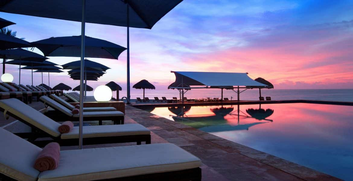 resort-pool-loungers-sunset