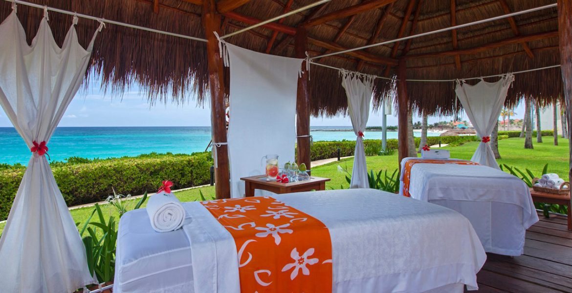 open-air-spa-by-beach-massage-table-orange-accent