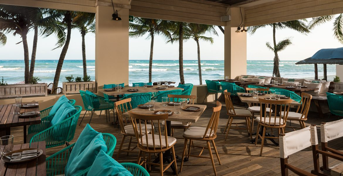 open-air-restaurant-on-ocean-turquoise-accents-decor