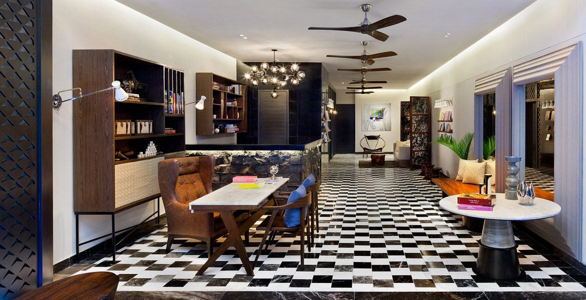 hotel-social-room-tables-books-checkered-tile-floor