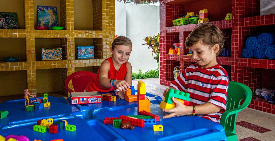 children-playing-resort-kids-club-blue-table-blocks
