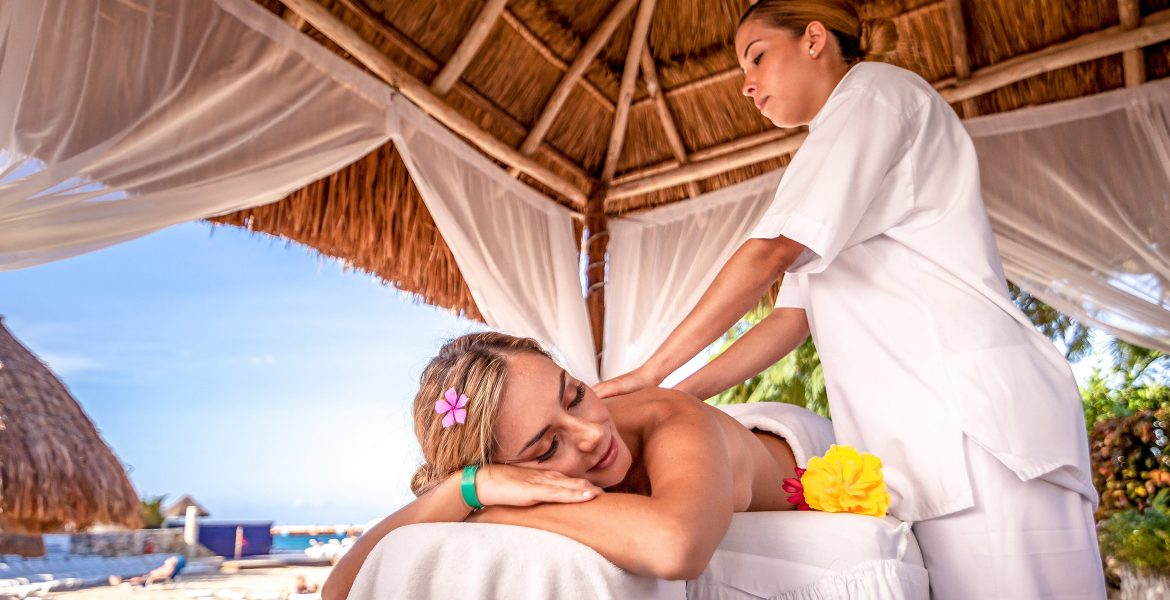 woman-receiving-massage-in-beach-cabana