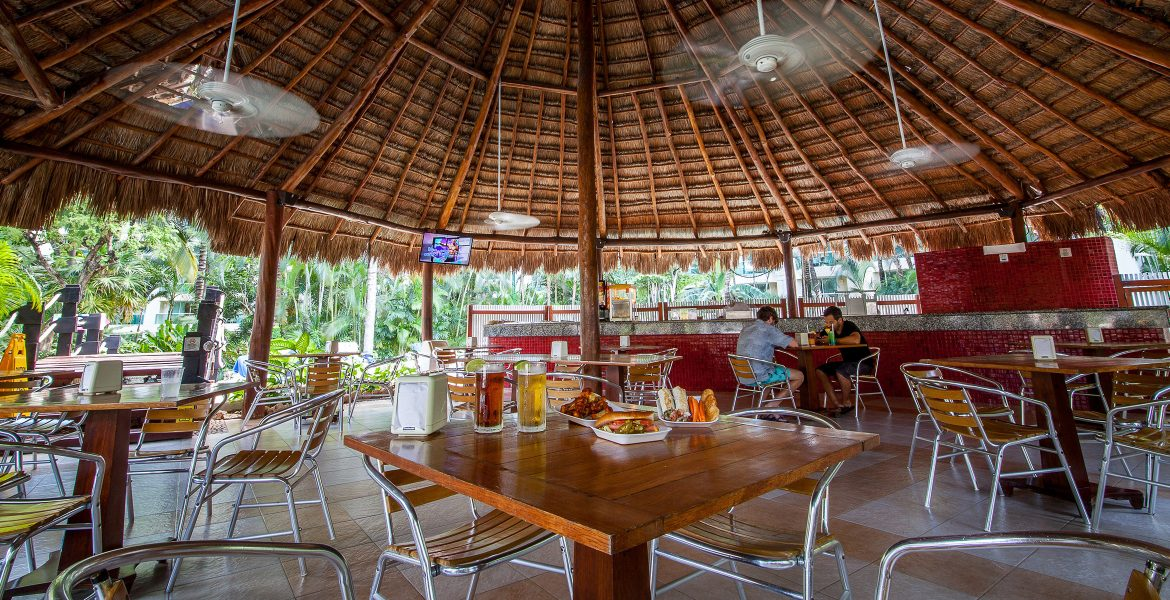 open-air-dining-under-palm-thatched-roof
