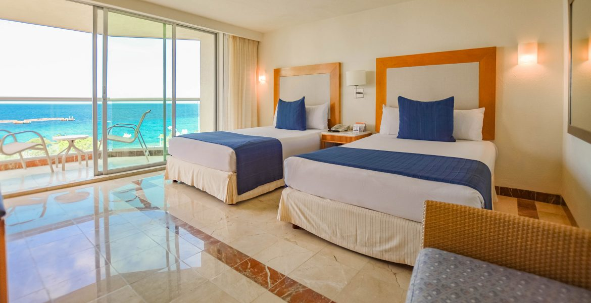beach-hotel-room-white-beds-blue-accents