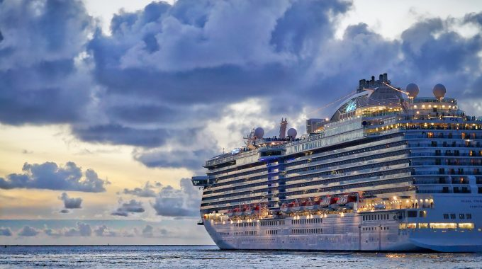 A cruise ship on the water at sunset