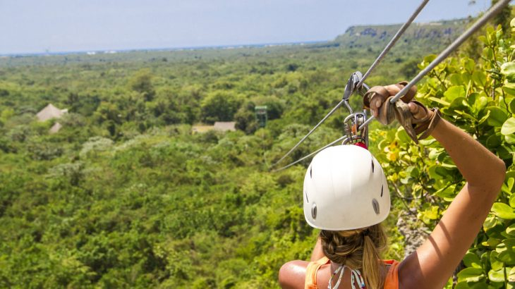 back-of-blonde-female-ziplining