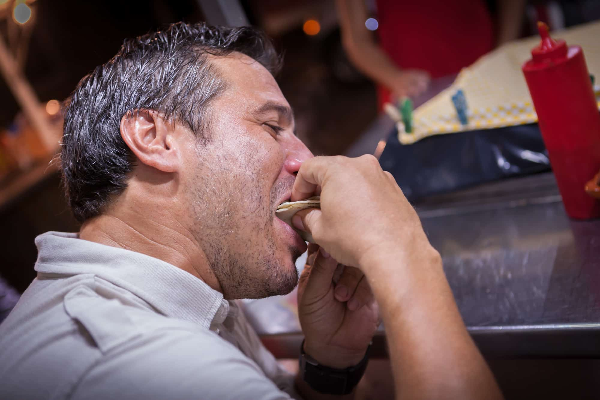 A man enjoying a bite of food on his Vallarta Food Tour